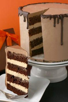 Tall 4-layer chocolate and caramel cake. Almost looks like an ice cream cake, too.