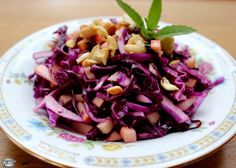 Purple cabbage makes for a glorious salad, especially with diced apples, a yummy vinaigrette and salty chopped nuts on top.