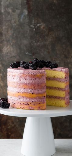 Blackberry-Mascarpone Lemon Cake. This strikingly beautiful, impressively tall cake features contrasting flavors and textures: tart lemon, sweet blackberries, and silky mascarpone whipped cream.