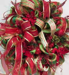 Deco Mesh Christmas Door Wreath Holiday Wreath which glistens and glitters with the red poinsettias, and metallic ribbons and deco mesh, by LadybugWreaths, $189.97