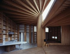 A Serene House With A Spiraling Wooden Roof