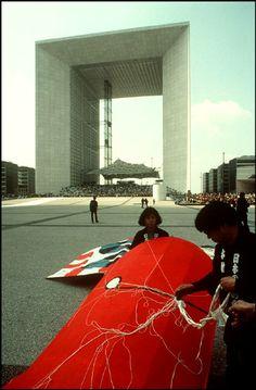 Rene Burri PARIS.La Grande Arche of La Defense district,group preparing of kite flying competition.