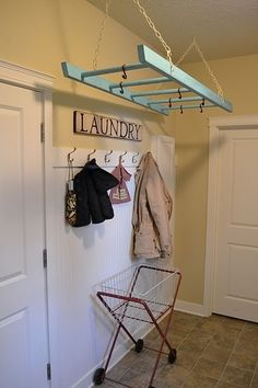 love this idea for a laundry room...paint it, add hooks, and hang :) if not just a pole above washer for hanging laundry, like what I have had in the past works well too...this just looks cute!