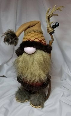 This little gnome is sure to snowshoe his way right into your heart! Floki is 15 inches tall and made out of all new materials including felt, fleece,faux fur, trim, jingle bells, wooden snowshoes, resin/wood staff, polyester fiberfill, rice for a weighted base and of course love! All
