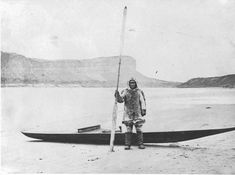 Inuit man with a Kayak next to Little Whale River - circa 1870