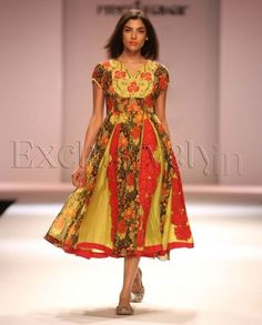 Lovey, love, love, love.  Fifties cocktail frock rendered in Indian fabrics.  Preeti Jhawar.