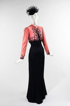 Elsa Schiaparelli (Italian, 1890–1973). Ensemble, summer 1940. The Metropolitan Museum of Art, New York. Brooklyn Museum Costume Collection at The Metropolitan Museum of Art, Gift of the Brooklyn Museum, 2009; Gift of Millicent Huttleston Rogers, 1951 (2009.300.1169a, b) | Designed for Schiaparelli's summer 1940 collection, this jacket was worn with a black mermaid dress and a jet beaded black tulle hat.