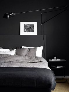 the head board in this pic could be an idea for the back of the day bed as something to lean up against its simple and witht he right bedding could look really nice.  sophisticated and not like the daybed was an afterthought.