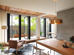 Glass doors open onto decked terraces at Taiwanese house renovation