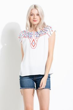 Loving the red and blue embroidery on this cream blouse! Perfect feminine boho piece for spring.