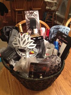Fifty shades of grey bachelorette gift including loofa, men scent body wash, vanilla bubble bath, lingerie, silk robe, hair ties, Ben wal balls, a crop, zip ties, rope, toothbrush, lube, red lipstick, worn men's jeans, mask, sleeping mask, wine glasses, wine, gift card to buy more books, knee high stockings, garter belt.