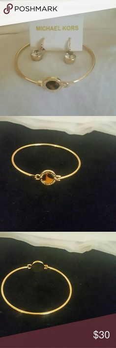 Mk jewelry set Bracelet is gold with Tiger eye around it says Micheal kors earrings are contract and delicate pendant MK Jewelry