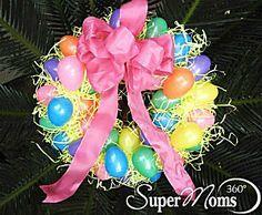 Easy Easter Egg Wreath - This simple spring wreath is easy to make and so cute! Tags: easy easter craft | easy spring craft | easy craft for kids | cute easter craft | cute spring craft | easter craft for kids | spring craft for kids | SuperMoms360.com