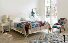 Patchwork cover and white painted bedroom furniture from The Sleep Room