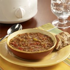 Slow Cooker Lentil Soup... A basic slow cooker vegetarian soup recipe made with brown lentils, tomatoes, celery and onion for comfort food goodness