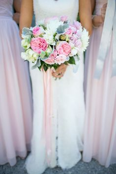#Bouquet - Pink Roses + White Dahlias plus streaming ribbons - Perfect for this outdoor wedding! See more on http://www.StyleMePretty.com/north-carolina-weddings/bald-head-island/2014/01/15/romantic-pink-green-wedding-at-bald-head-island-club/ Theo Milo Photography