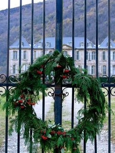 A simple wreath on the Château's main gates, which we made together as a family. We collected only pieces from the Château, from the green fir tree branches to old wire and cable used to hold it together. In the park, the horses followed us around as we foraged for holly and berries.