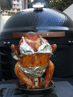 Beer can chicken on my Kamado Joe.  She is smoking!!!
