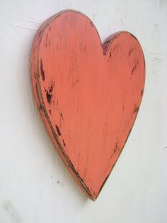Shabby chic rustic wooden heart painted to use as a guest book