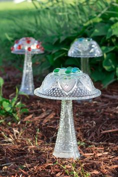 Enjoy this beautiful Glass Mushroom in your garden all year !! Add a touch of beauty to your garden with this Glass Garden Mushroom. Made from Vintage & Modern Glassware pieces. My Glass Mushrooms are bonded securely with 100% Outdoor Silicone Adhesive. I use plenty of Adhesive to bond each piece !! Simply hide the base in your flower bed under mulch or pebble covering. These cute mushrooms look...