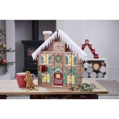 Go all out for your advent this Christmas and make a gingerbread-esque wonderland! This gingerbread house advent is guaranteed to be one that's passed down through the generations, with all love and detail that goes into it. Wooden House Advent Calendar, Diy Advent Calendar, Christmas Candles, Diy Christmas Ornaments, Christmas Decorations, Christmas Ideas, Christmas Houses, Holiday Themes, Holiday Decor