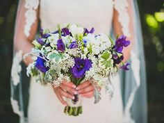 Gorgeous wedding bouquet with pops of purple! Laurel Designs