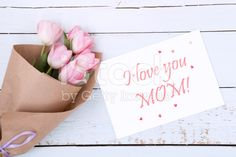 Beautiful bouquet of pink tulips next to a white envelope royalty-free stock photo