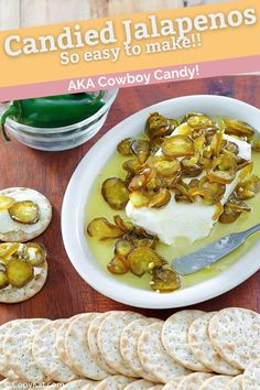 Candied jalapenos have a perfect sweet/hot balance. Also known as Cowboy Candy, these delightful sugared peppers are super easy to make in the refrigerator with only 2 ingredients. Great burger topping or poured over cream cheese for a snack or appetizer. Click to get the recipe now! #jalapeno #condiments #peppers #appetizerrecipes #candied