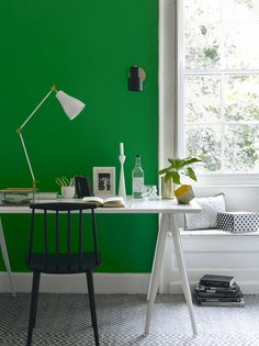 Home office: You can't beat fresh white woodwork teamed with a bright colour - it looks really striking and the white creates the perfect contrast and balance to this green wall. Black is used here as the accent colour and it provides depth to the scheme while the copper pieces add warmth. Accessorise with monochromatic pieces like stationery boxes, desk and wall lighting and a smart graphic style rug. (Photo: Pooky). Find more decorating ideas at housebeautiful.co.uk