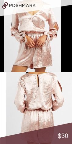 Satin Split Sleeve Romper 🎀 Lightweight satin fabric flaunts a fabulous sheen to shape this one-piece into a flirty, party look! Long sleeves drape into dainty tied cuffs, with sexy slits along the way. Elastic holds the relaxed shorts, while a deep V-neckline seals into a button-topped keyhole in back. Dresses Mini