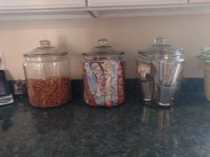 I have four children and learned some mad organization skills along the way.   I bought these large glass jars at Walmart and filled one with pretzels, with four kids it empties quickly!  The one in the middle has my French Provincial cloth napkins rolled up in, pretty to look at and easy to set the table! The third jar has 3 different sets of heirloom sterling silverware stored in pewter julep cups, a very elegant and easy display!