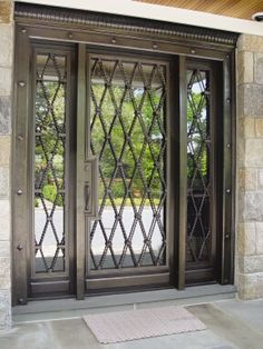 duplicate front door height -divided into two doors use beaded molding to make x's on either side of glass inset top with curvy cut solid wood. Iron Front Door, Exterior Front Doors, Entrance Doors, Patio Doors, Front Door Design, Gate Design, House Design, Cool Doors, Unique Doors