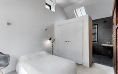 Small minimalist bedroom with suite bathroom