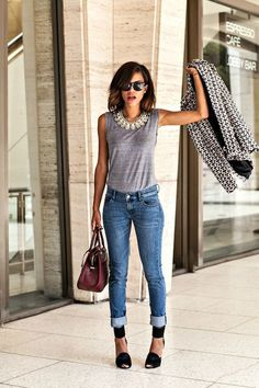Shop this look for $184:  http://lookastic.com/women/looks/sleeveless-top-and-statement-necklace-and-skinny-jeans-and-heels-and-satchel-bag-and-blazer/2393  — Grey Sleeveless Top  — Silver Statement Necklace  — Blue Skinny Jeans  — Black Suede Pumps  — Burgundy Leather Satchel Bag  — Black and White Geometric Blazer