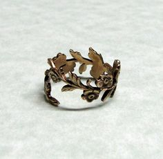 Forest Leaf Spray Ring band by ranaway on Etsy, $37.99 ~ I think I would like it in a white/silver metal