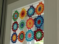 Beautiful and colourful crochet motifs adorn window