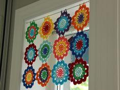 Beautiful and colourful crochet motifs adorn window