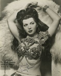 Old promo shots of burlesque dancers from the 1940s and 50s. I collect them and hang them in my closet because, well, people would probably think having old nudie pictures around the house is strange...