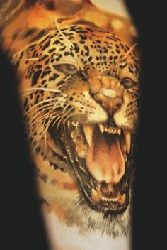 Realistic cheetah tattoo by Andrey Barkov