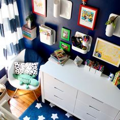 Small boys room, shared boys room, small nyc kids room, kids room, Storing kids art supplies, art storage, art supply storage, school supply storage, school supply storage tips, kids bedroom, wall storage ideas, striped curtains, blue wall, dark walls small spaces, kids gallery wall,