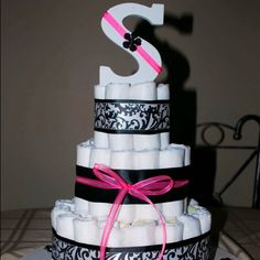 Elegant diaper cake for baby showers! W the right initial! This would be perfect! Baby Shower Crafts, Baby Crafts, Baby Shower Parties, Shower Gifts, Baby Showers, Diaper Crafts, Diy Diaper Cake, Nappy Cakes, Baby Time