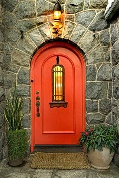 Magical Garden for a 1929 Spanish Colonial Revival — Love the orange door :)
