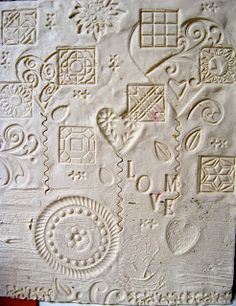 The artist is Alyice Edrich. It is made from clay. the texture is created by imprints made in clay
