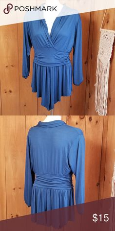 "Bellino Peacock Blue Jersey Long Sleeve Blouse 1X Bellino Peacock Blue Jersey Long Sleeve Blouse Plus Size Women's 1X  measurements lying flat: 19"" chest 16"" underarm to wrist 28"" length  97% rayon 3% spandex Made in USA Bellino Clothing Tops Blouses"