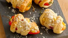 Perk up your appetizer party with cheesy, corn-stuffed peppers wrapped in flaky crescents.