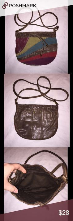 Small Fossil Purse Small fossil purse. Very cute, has a cross body style strap. In wonderful used condition. Measurements are *approximately* - 8 1/2 inches wide, 7 inches deep, and a 24 inch strap drop. Fossil Bags Crossbody Bags