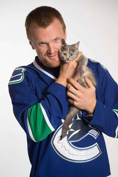 Vancouver Canucks: Henrik Sedin and a kitten from the BC SPCA Hockey Games, Hockey Players, Ice Hockey, Nottingham Panthers, Henrik Sedin, Three Wise Men, Vancouver Canucks, Pittsburgh Penguins, Nhl