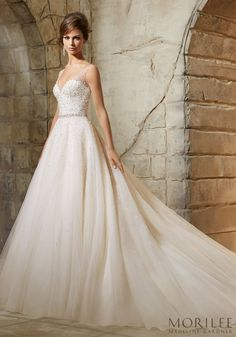 Morilee | Madeline Gardner Elegant and Glam Bridal Gown.  This tulle ball gown is sprinkled with sparkly crystal beading on a delicate and sheer  V Neckline and Bodice.  This gorgeous open back wedding dress is available in white/ ivory and blush/ light gold.  Style 5376.