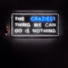 'The craziest thing we can do is nothing' Neon light, quote, white and blue