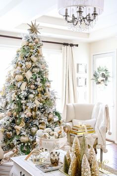 Gold and silver decorated, flocked Christmas tree and gifts. family room